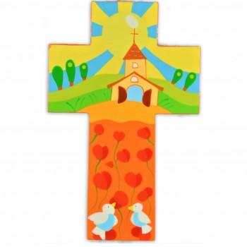 Croix avec une église et son champs de coquelicots