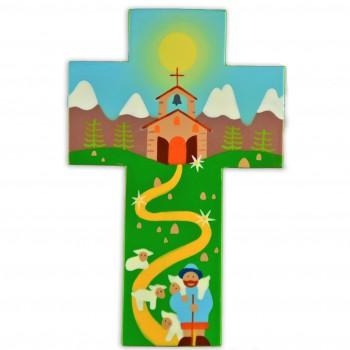 Croix avec église de montagne et son berger